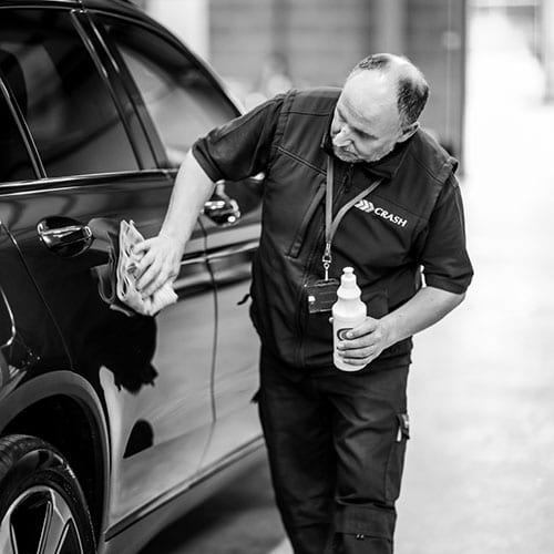 John Glover cleaning a car at CRASH Services